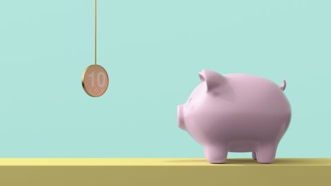 piggy bank looking at hanging coin
