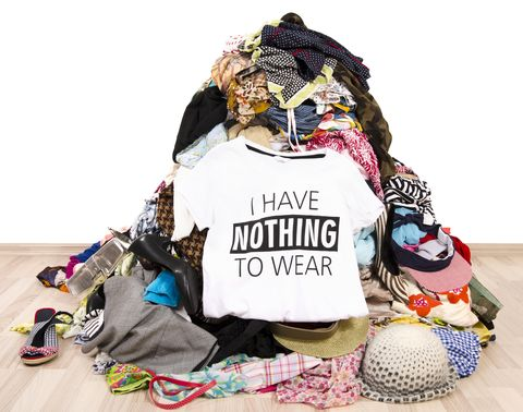 Pile of many clothes and a nothing to wear top.