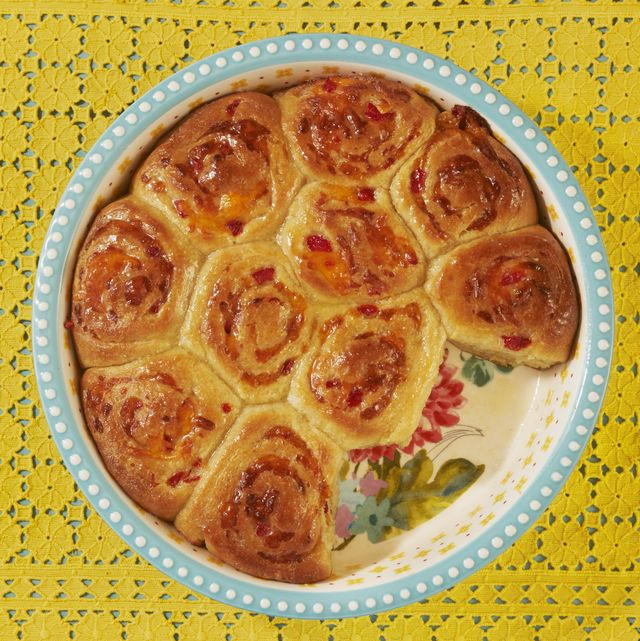 pimiento cheese buns in baking dish with yellow lace fabric