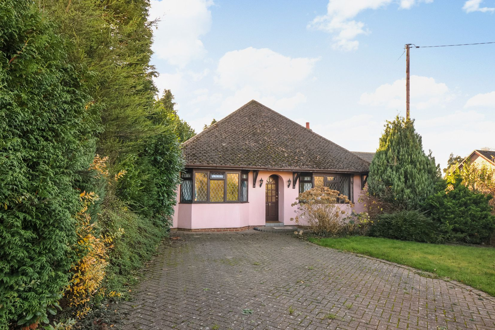 Charming pink bungalow on sale for £400,000 in Reading