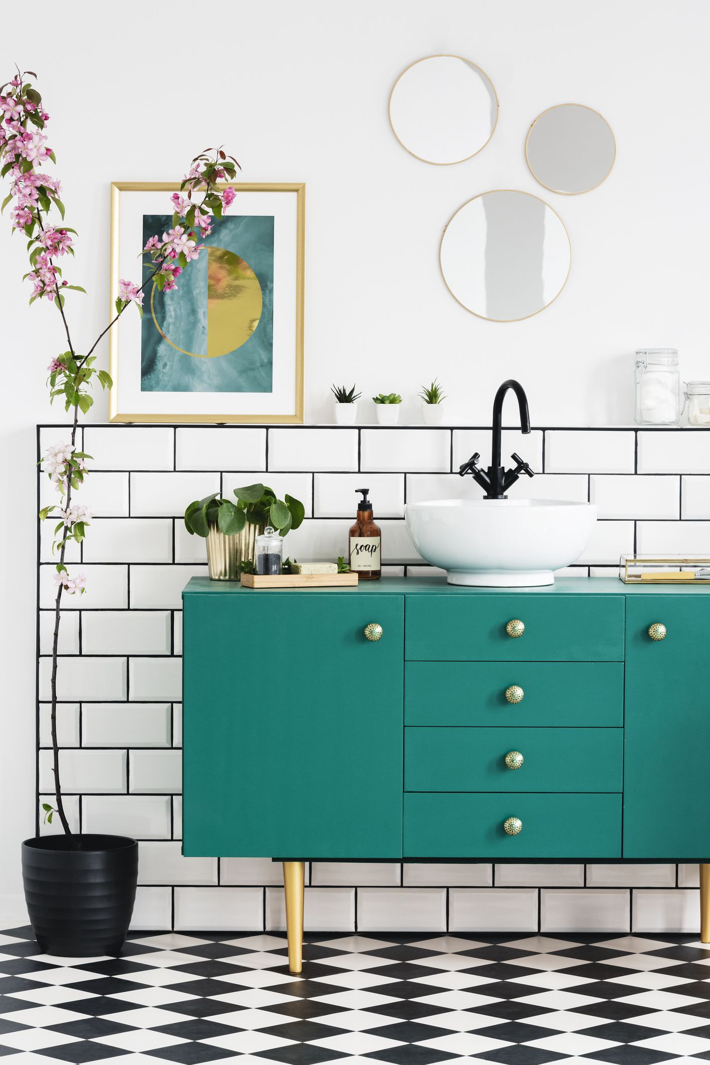 Charming Pink Flowers Next To Green Cabinet In Bathroom Interior With Posters And  Round Mirrors. Real