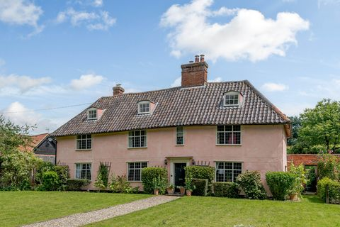 pink property with a vineyard for sale in suffolk