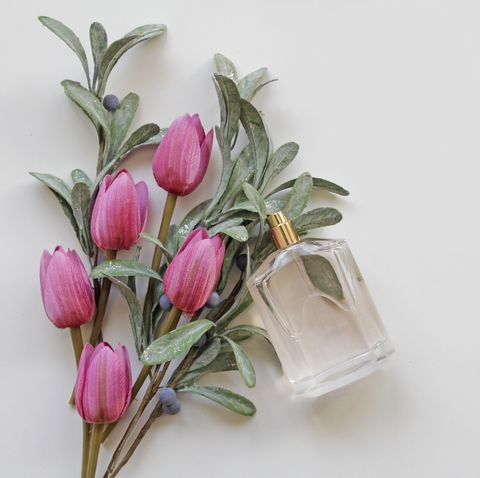 pink tulips bouquet and perfume bottle