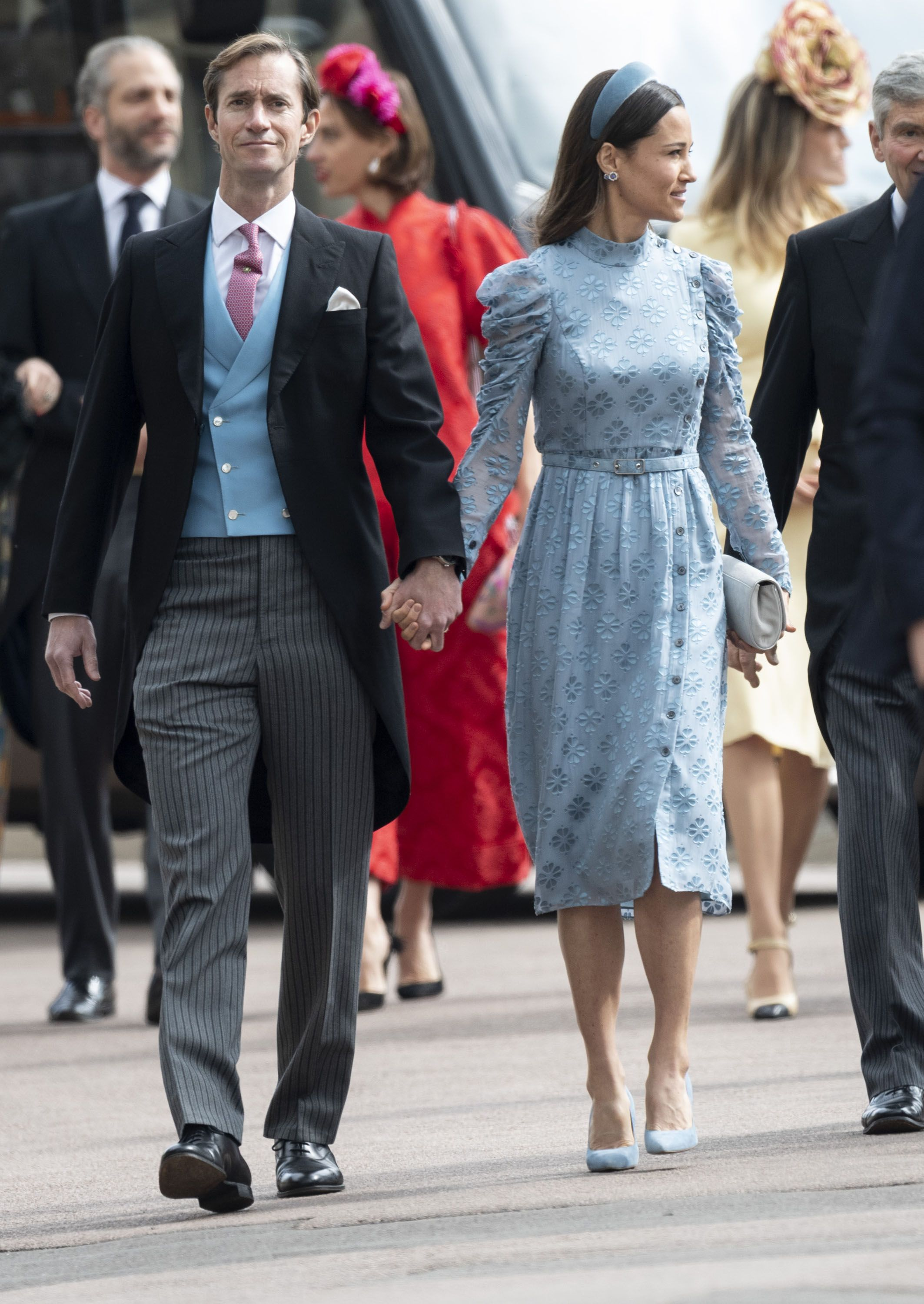 Wearing Kate Spade and a hatband—a trend started by her sister.