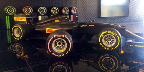 Tire, Formula one tyres, Automotive tire, Vehicle, Car, Wheel, Automotive wheel system, Rim, Auto part, Race car,