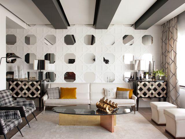 un piso en el barrio de salamanca, madrid, decorado con blanco, gris y espejos