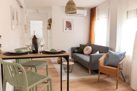 salón abierto con comedor y decoración boho