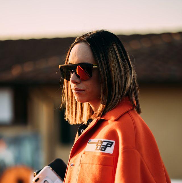 Orange, Eyewear, Sunglasses, Street fashion, Outerwear, Uniform, Glasses,