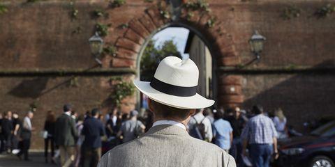 Hat, Headgear, Fashion accessory, Fedora, Temple, Crowd,