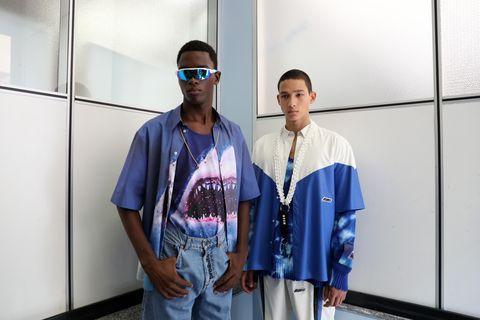 Blue, Fashion, Eyewear, Street fashion, Shoulder, T-shirt, Outerwear, Fashion design, Uniform, Sleeve,