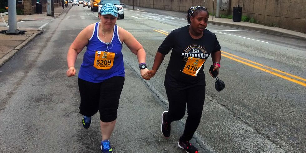 Pittsburgh Marathon Final Finishers - Last Place Runners Cross Finish Line  Holding Hands