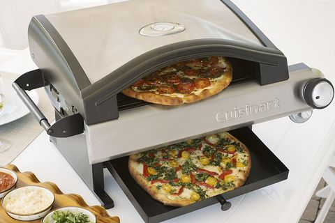 Dish, Food, Kitchen appliance, Cuisine, Oven, Cookware and bakeware, Small appliance, Pizza stone, Ingredient, Pizza cutter,