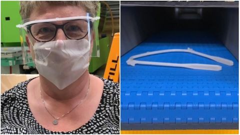 Woman with face shield and part of face shield in production factory
