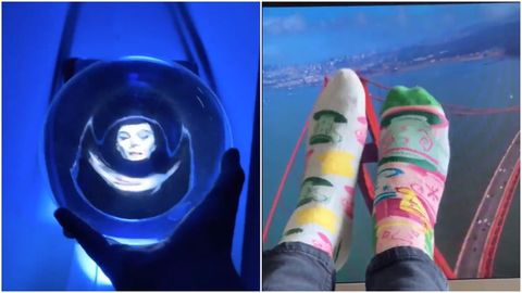 woman holding Haunted mansion orb and feet in air over photo of golden gate bridge