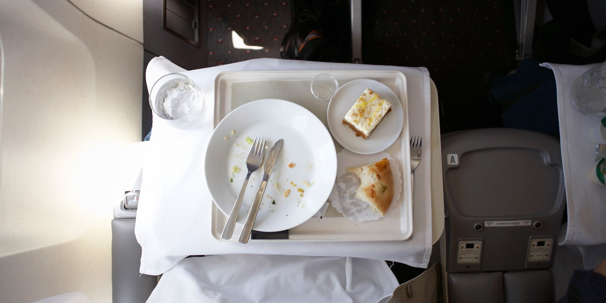 The best food and drink to eat before and during a flight to avoid bloating