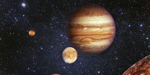 Planet Jupiter and his satellites in outer space