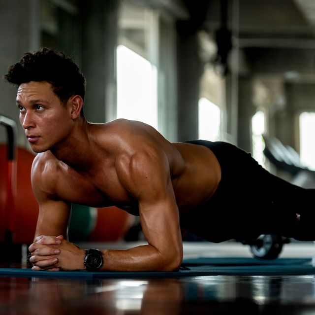 trainer man exercise for  functional plank training and gym the gym workout for healthy care and body building  fitness instructor exercising the fitness healthy sport concept