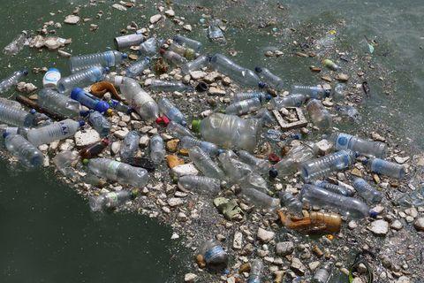 Plastic bottles & garbage floating in Indian Ocean.