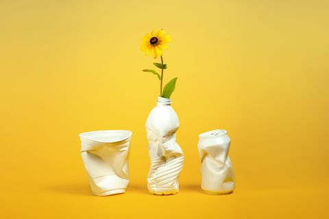 Plastic containers repurposed as vases