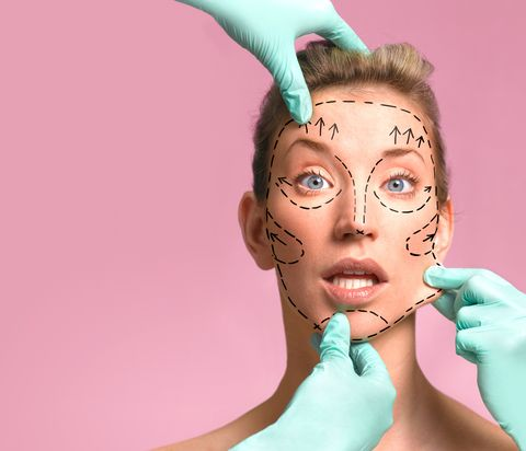 Plastic surgeon marking up for surgery