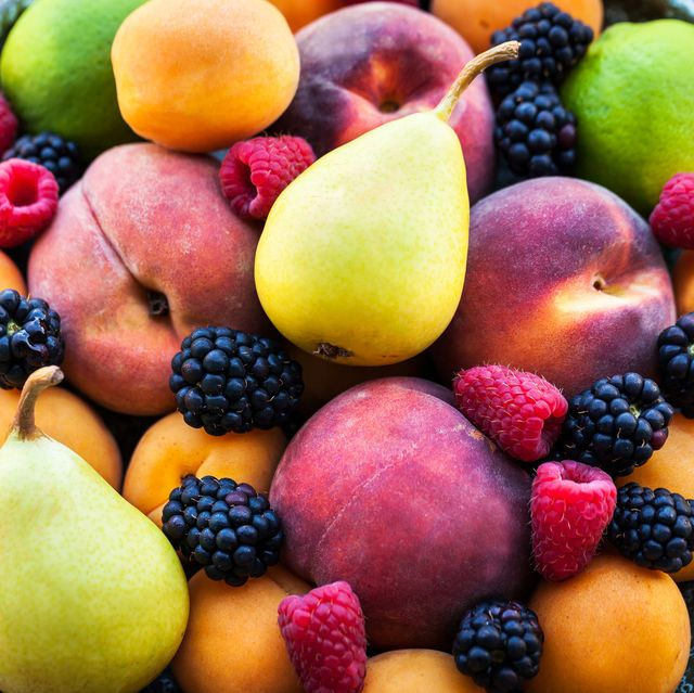 plate of various summer fresh ripe berries and fruits