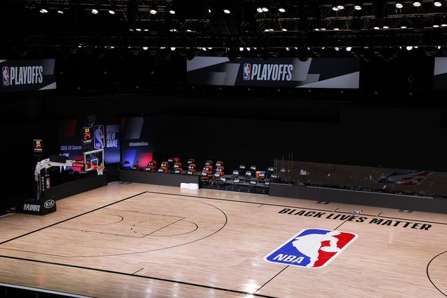 lake buena vista, florida   august 26 an empty court and bench is shown with no signage following the scheduled start time in game five of the eastern conference first round between the milwaukee bucks and the orlando magic during the 2020 nba playoffs at adventhealth arena at espn wide world of sports complex on august 26, 2020 in lake buena vista, florida the milwaukee buck have boycotted game 5 reportedly to protest the shooting of jacob blake in kenosha, wisconsin note to user user expressly acknowledges and agrees that, by downloading and or using this photograph, user is consenting to the terms and conditions of the getty images license agreement photo by kevin c coxgetty images