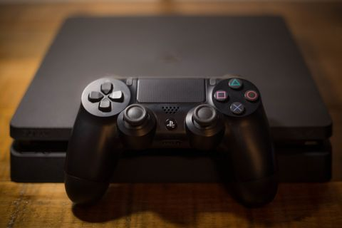 A Sony PlayStation 4 video game console with controller
