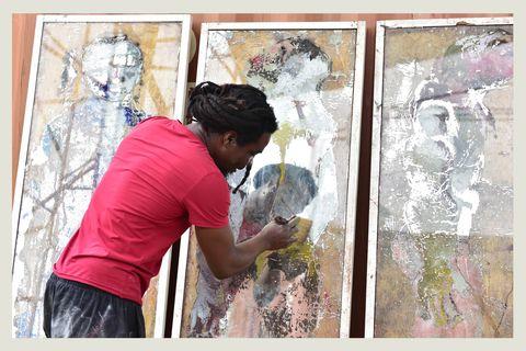 togolese artist sadikou oukpedjo paints in his workshop in bingerville, outside abidjan, ivory coast