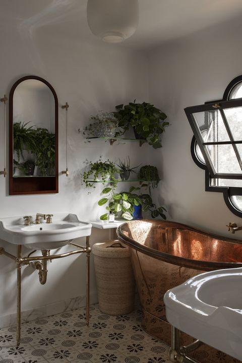 copper bath tub, white basin, plants