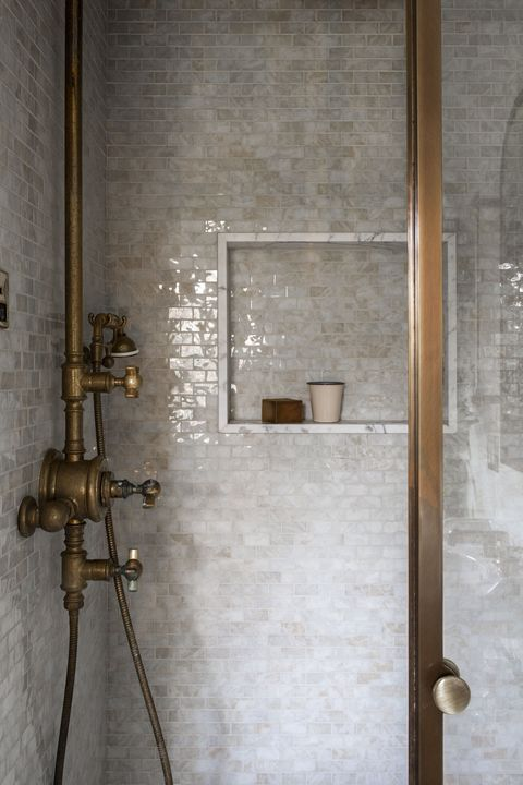 shower, white tiles, copper faucet and taps
