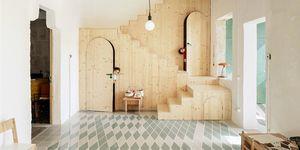Proyecto de ampliación de una casa con paneles de madera contrachapada