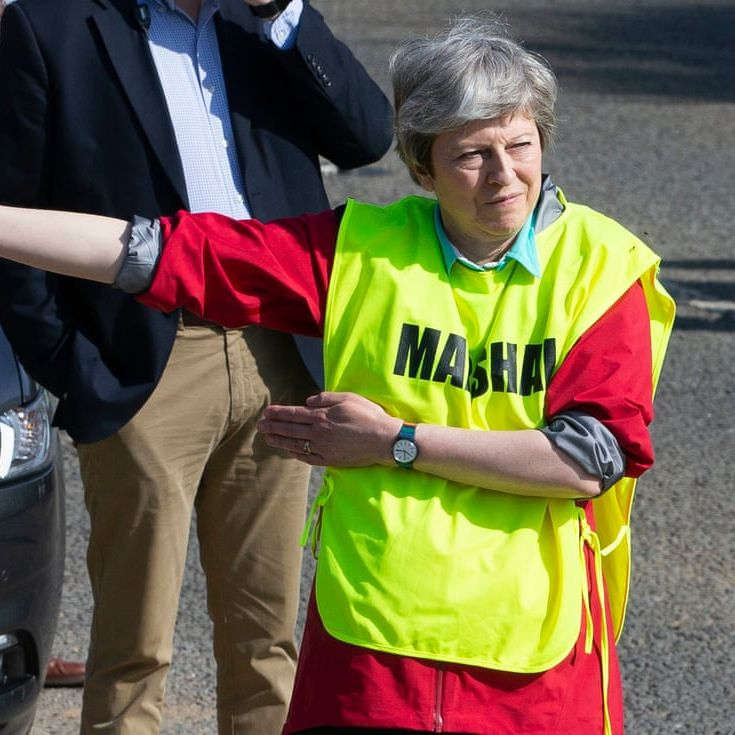 Theresa May takes highly visible role in local running race