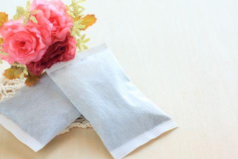 pocket warmer and plastic flower for winter image