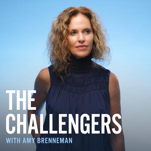 amy brenneman in a blue shirt on a blue background