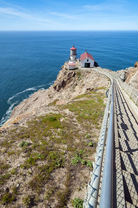 Lighthouse, Coast, Tower, Sea, Promontory, Sky, Headland, Cape, Coastal and oceanic landforms, Ocean,