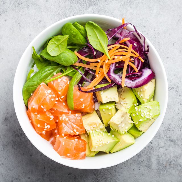poke bowl with salmon, spinach, avocado, carrot, and red cabbage