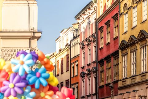 Poland, Krakow, Old Town, Main Square, town houses and flower balloons