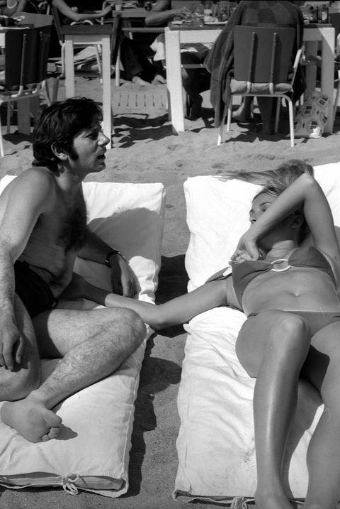 Photograph, Snapshot, Monochrome, Black-and-white, Leg, Sitting, Photography, Sun tanning, Barechested, Fun,