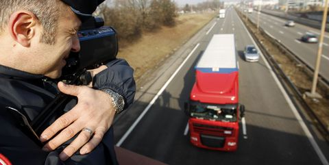 police officers checking the speed of heavy trucks