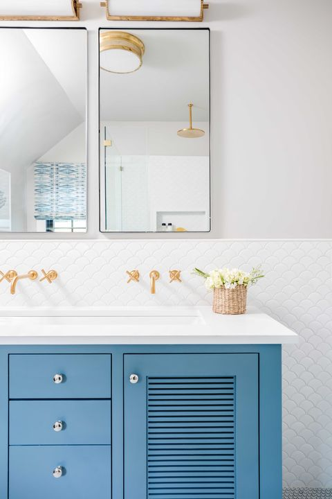 guest bathroom, white scallop tiles, blue cabinets