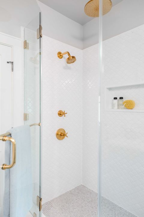 shower, white scallop tiles, guest bathroom, gold faucets and hardware