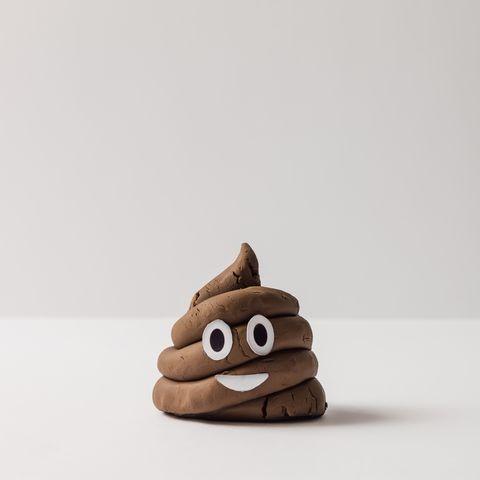 Poop emoticon on bright background.