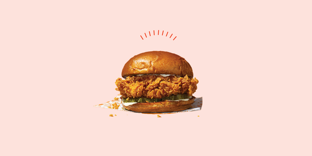 a photo of the popeyes fried chicken sandwich on a pink background