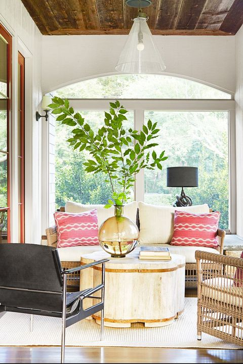 screened in porch with pink pillows