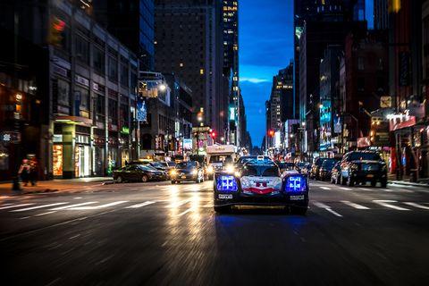 Urban area, Night, Metropolis, City, Metropolitan area, Street, Mode of transport, Vehicle, Light, Landmark,