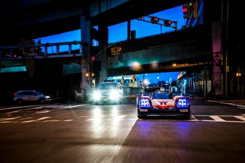 Vehicle, Car, Sports car racing, Race car, Sports car, Performance car, Mode of transport, Night, Automotive design, Automotive lighting,