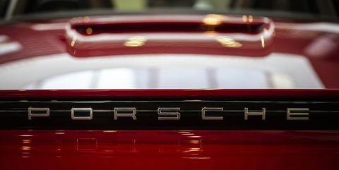 Red, Vehicle, Car, Automotive exterior, Automotive design, Automotive lighting, Hood, Grille,