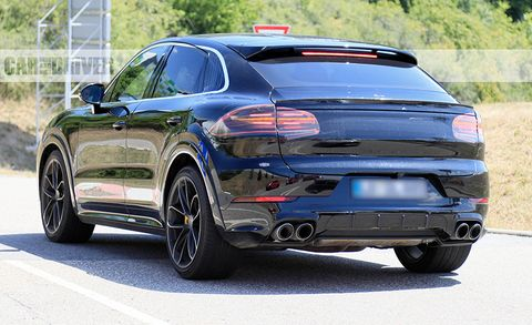 porsche cayenne coupe spied yep  fastback version  coming news car  driver