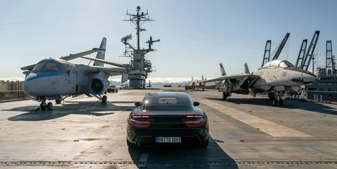 Watch Porsche's Taycan Super EV in a Wild Stunt on an Aircraft Carrier
