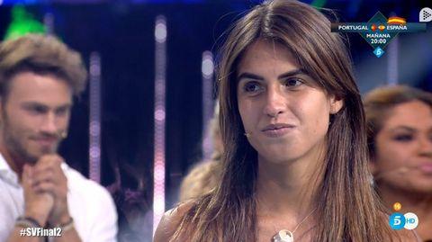 Hair, Nose, Chest, Long hair, Brown hair, Television presenter, Black hair,